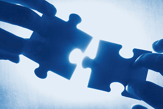 Image of hands holding puzzle pieces